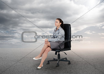 Attractive businesswoman sitting on a chair