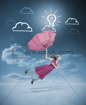 Glamour woman flying with a red umbrella