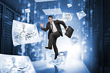 Businessman jumping in a corridor with drawings around