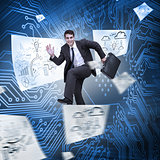 Businessman jumping with drawings floating around