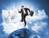 Businessman jumping over a planet with drawings floating