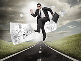 Businessman jumping on a road with drawings floating