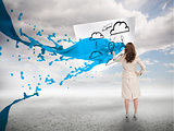 Creative businesswoman with blue paint splash