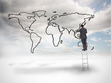Businessman on a ladder drawing a world map