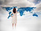 Businesswoman touching at a world map