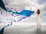 Businesswoman drawing on a paper next to paint splash