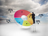 Businessman drawing a colorful pie chart