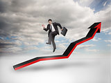 Businessman jumping over a red arrow pointing up