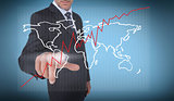 Businessman selecting a world map