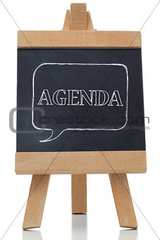 Agenda written on a blackboard