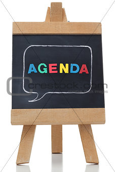 Agenda written on a blackboard with colored letters