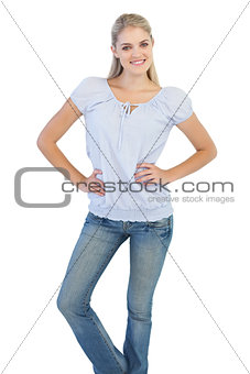 Blonde woman with hands on her hips