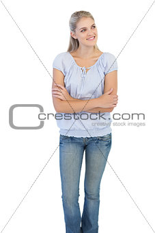 Smiling blonde woman crossing her arms