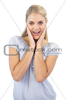 Smiling blonde woman is surprised