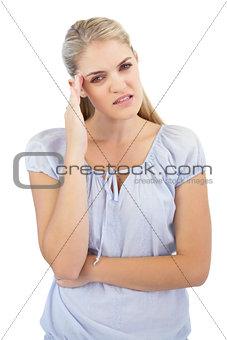 Blonde woman has headache
