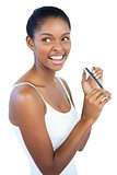 Smiling woman using nail file