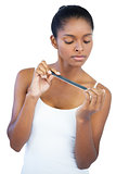 Serious young woman using nail file