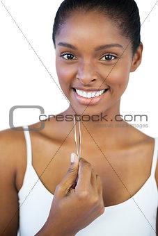 Smiling woman holding her tweezers
