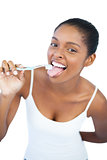 Funny woman brushing her tongue with toothbrush