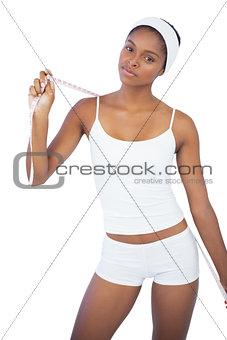 Slim woman holding measuring tape