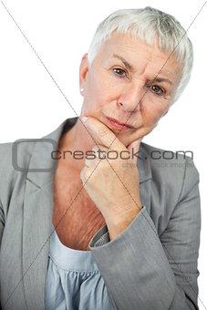Thinking woman looking at camera