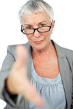 Serious woman with glasses presenting her hand for handshake