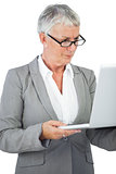 Businesswoman with glasses watching her laptop