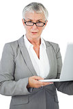 Businesswoman with glasses holding her laptop