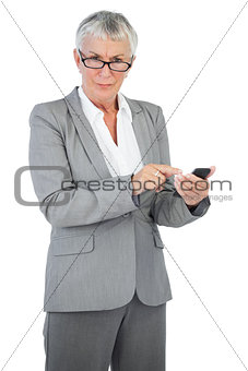 Businesswoman with glasses using her mobile phone