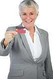 Happy businesswoman showing her credit card