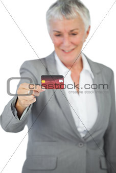 Cheerful businesswoman showing her credit card