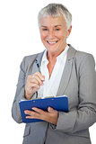 Smiling businesswoman holding her clipboard