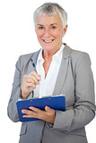 Happy businesswoman using her clipboard