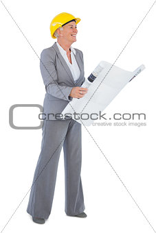 Smiling architect with plan wearing hardhat