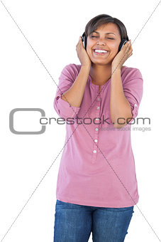 Beautiful woman smiling and listening to music