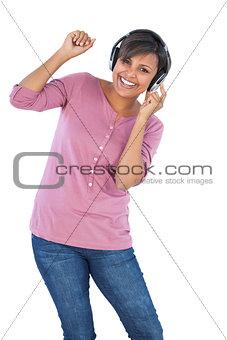 Beautiful woman enjoying music and dancing