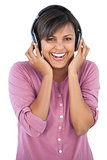 Cute woman enjoying music