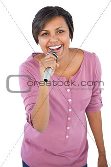 Brunette singing with her microphone