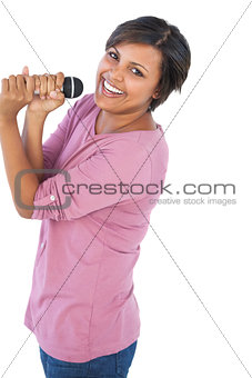 Woman holding microphone for singing