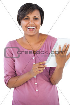 Happy woman holding tablet pc