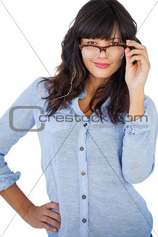 Cute woman wearing glasses with her hand on hip