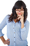 Beautiful woman wearing glasses with her hand on hip