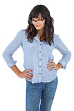 Beautiful woman with her hands on hips and wearing glasses