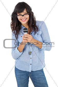 Young woman wearing glasses and singing