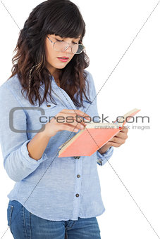Brunette wearing glasses and reading her book