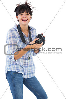 Cheerful young woman taking picture with her camera