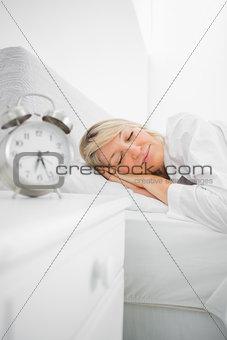 Blonde woman in bed asleep