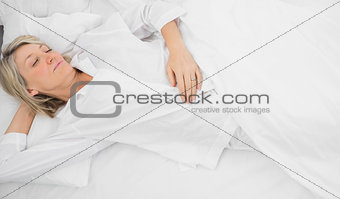 Blonde woman in a deep sleep