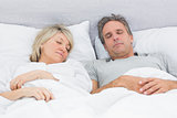 Couple sleeping peacefully in their bed