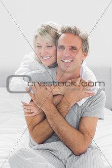 Embracing couple smiling at camera